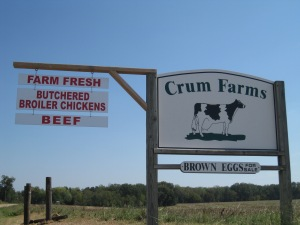the road-side sign advertising what Crum Farms has on offer