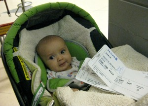 The Child holds our tickets to Indianapolis.